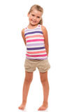 Cute little girl standing on white holding hands behind back Stock Images