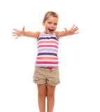 Cute little girl standing on white stretch her arms forward Stock Photography