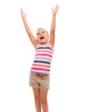 Cute little girl standing on white stretching her arms up Royalty Free Stock Photos