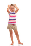 Cute little girl standing on white whith hands on her head Stock Image