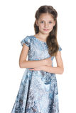 Cute little girl stands against the white stock photo