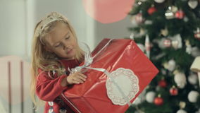 Cute little girl stands near stylishly decorated stock footage