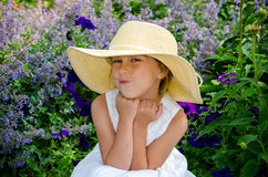 Cute little girl in a straw hat stock photography