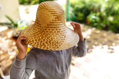 Cute little girl in straw hat, spring outdoor. Royalty Free Stock Photos
