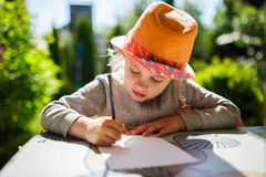 Cute little girl in straw hat, spring outdoor. Stock Photo