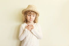 Cute little girl in straw hat Stock Photos
