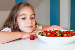 Cute little girl with strawberry Royalty Free Stock Image