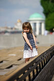 Cute little girl in the street. Cute little girl posing on the sun. Moscow, Russia Royalty Free Stock Photos