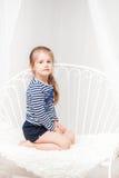 Cute  little girl in striped shirt Stock Photos