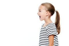 Cute little girl in stripped T-shirt talking. Speech therapy concept over white background. Cute little girl in stripped T-shirt talking. Speech therapy concept royalty free stock photos