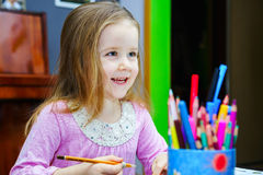 Cute little girl studing to speaking and writing letters at home Royalty Free Stock Images