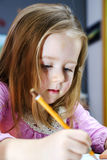Cute little girl studing to speaking and writing letters at home. Lesson with her mother Stock Photos