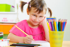 Cute little girl study at home Royalty Free Stock Photography