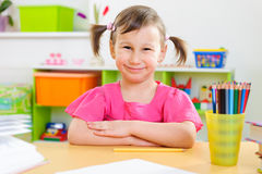 Cute little girl study at home Royalty Free Stock Photos