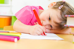 Cute little girl study at home Stock Photos