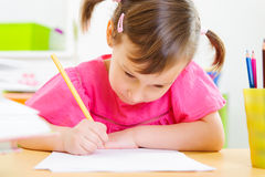 Cute little girl study at home Royalty Free Stock Images