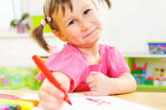 Cute little girl study at home Stock Photo