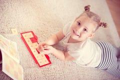 Cute little girl study mathematics Stock Images