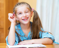 Cute little girl studying Royalty Free Stock Photography