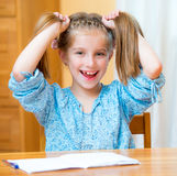Cute little girl studying Royalty Free Stock Images