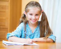 Cute little girl studying Royalty Free Stock Photos