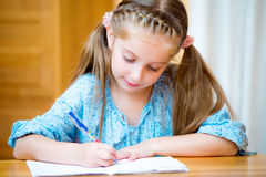 Cute little girl studying Royalty Free Stock Image