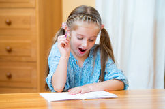 Cute little girl studying stock photo