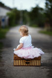 Cute little girl with suitcase Stock Photography