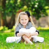 Cute little girl in a summer park Royalty Free Stock Photos