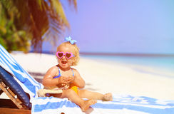 Cute little girl with sunblock cream on beach Royalty Free Stock Images