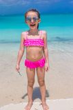 Cute little girl in sunglasses at beach during royalty free stock image