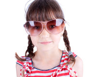 Cute  little girl with sunglasses posing Stock Photos