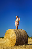 Cute little girl with sunglasses posing on the haystack Royalty Free Stock Image