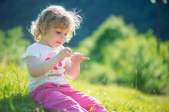 Cute little girl at sunny meadow Stock Images