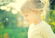 Cute little girl in the sunshine. Stock Photography