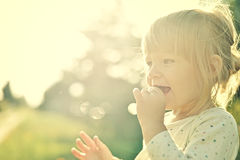 Cute little girl in the sunshine. Royalty Free Stock Photo