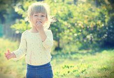 Cute little girl in the sunshine. Royalty Free Stock Photos