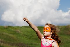 Cute little girl in Super hero mask Royalty Free Stock Image