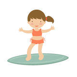 Cute little girl surfing Royalty Free Stock Photos