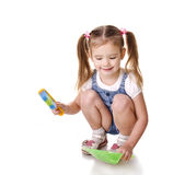 Cute little girl sweeps a floor  Royalty Free Stock Photo
