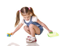 Cute little girl sweeps a floor isolated Royalty Free Stock Images