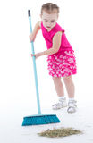 Cute little girl sweeps a floor isolated on white Stock Images
