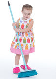 Cute little girl sweeps a floor isolated on white Stock Photo