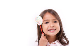 Cute little girl with sweet colorful marshmallow Royalty Free Stock Photo