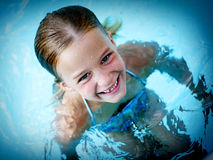 Cute little girl swimming Royalty Free Stock Photography