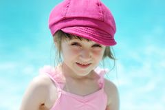 Cute little girl by a swimming pool Stock Image