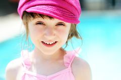 Cute little girl by a swimming pool Stock Photo