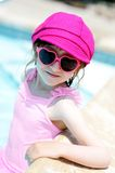 Cute little girl by a swimming pool Royalty Free Stock Photo