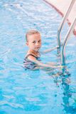 Cute little girl in swimming pool Royalty Free Stock Image