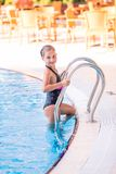 Cute little girl in swimming pool Stock Photo